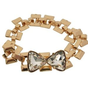 Gold plated bracelet with crystal bow